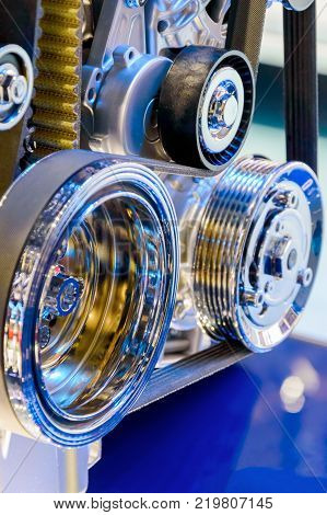 Closeup of modern automobile motor car engine part focus on pulley with belt.
