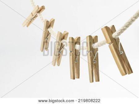 Clothes clips on a rope isolated on white background - loundry peg on string isolated