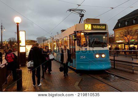 Gothenburg Sweden - November 1 2017: A blue tram of class M31 in service on line 2 at stop Kungsportsplatsen during the evning.