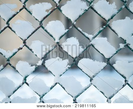 the snow stuck to the mesh fence