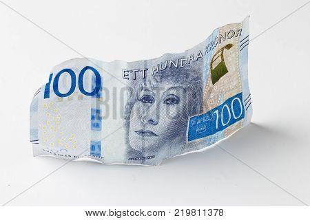 Stockholm Sweden - February 16 2017: Swedish banknote SEK 100 introduced 2016 with a portrait of Greta Garbo standig on light background.