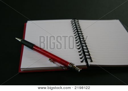 Notebook With Red Pen On Black Background 52