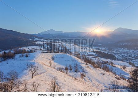 Fantastic winter landscape and trodden tourist path leading into the mountains. On the eve of the holiday. Carpathian, Ukraine, Europe.