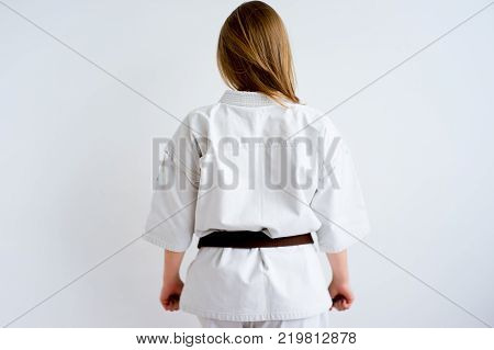 A portrait of a karate girl training