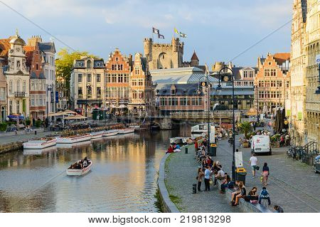 View of colorful traditional houses along the canal and boats in popular touristic city of Ghent, Belgium, October, 01, 2014.