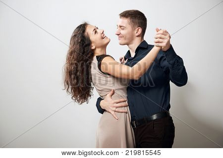 romantic couple dancing on white background