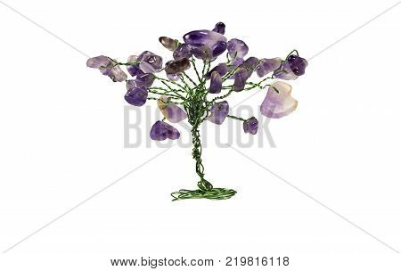 Purple amethyst, handmade, tree of amethyst stones isolated on white background. Ural gemstones.