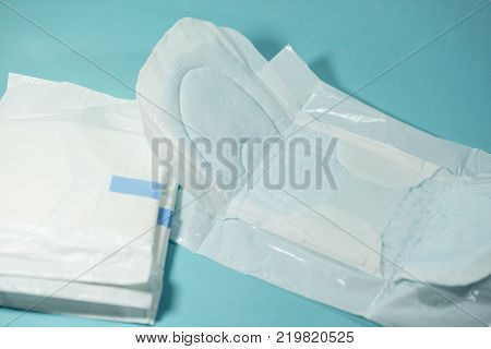 Sanitary napkin for woman Absorb easily dry on blue background