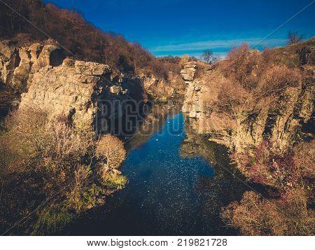 Beautiful lake in the rocks in autumn. Buky canyon, Ukraine