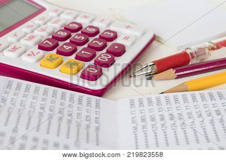 account passbook for management of business and check money with calculator