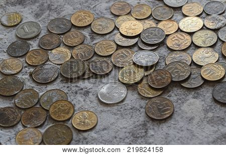 Coins in the flour in the balance. Rubles and kopecks. The money on the scales.