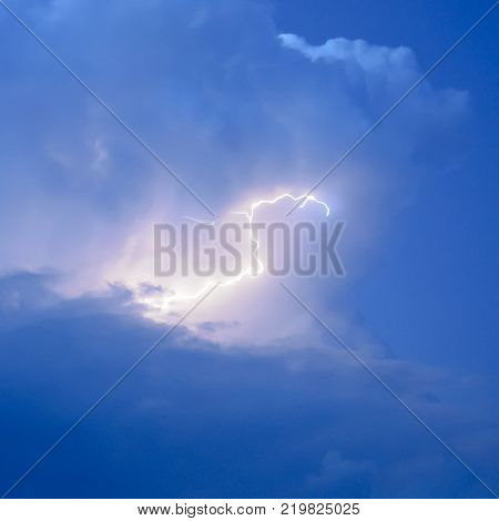 Lightnings in storm clouds. Peals of a thunder and the sparkling lightnings in clouds.