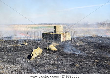 Protective strengthening of concrete for firing. Destruction and fire on the battlefield.