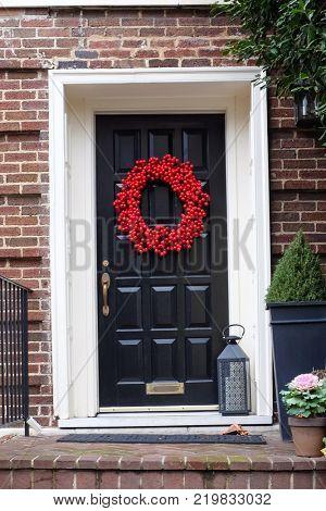 Black door with Christmas wreath
