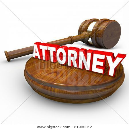 The word attorney on a wood block with a gavel beside it, illustrating the authority and importance of a lawyer in helping  you with your court case