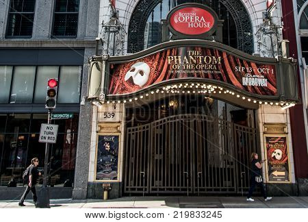 Boston, MA USA 06.09.2017 - Front of the Opera House Theater iconic neon sign dominates Washington Street Theater District