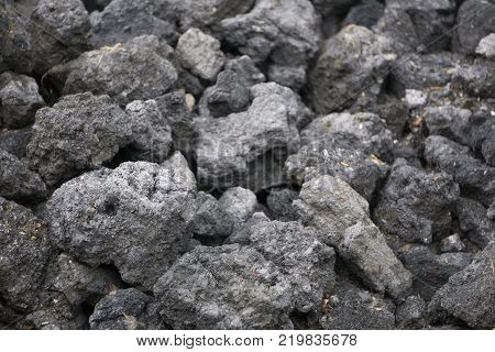 dark texture of burnt coal slag stones vintage wall  white