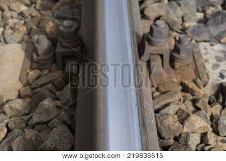 the roadbed  rails in landscape. Rails in a the land.