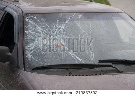 Broken side window in a car.  shattered glass
