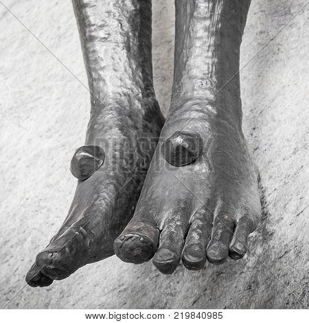 Nailed feet detail of statue of Jesus Christ crucified.