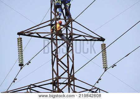 Silhouette electrician work installation of high voltage in high voltage stations safely and systematically over blurred poster