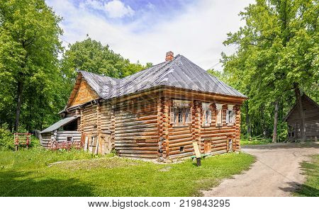 Nizhny Novgorod, Russia - June 10, 2017: Pavlova's House in the Museum of Wooden Architecture Schelokovsky Farm in a summer sunny day.