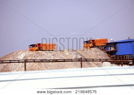 Extracting and mining potassium and magnesium salts.Large excavator machine and Huge mountains of waste ore in the extraction of potassium.