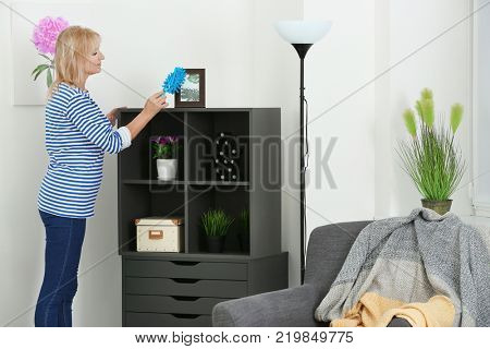 Mature woman cleaning her flat