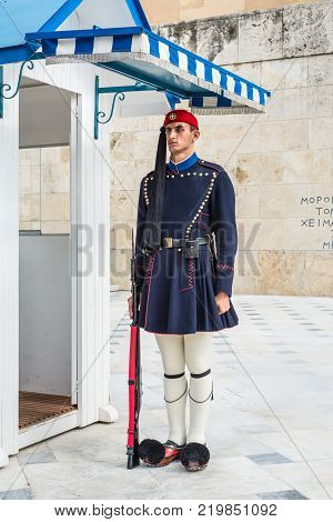 Athens Greece - November 1 2017: Evzone guarding at Syntagma square in Athens. Evzones are traditional Greek Royal guards used for ceremonial purposes.