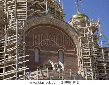 unfinished in waves and new Church of yellow brick