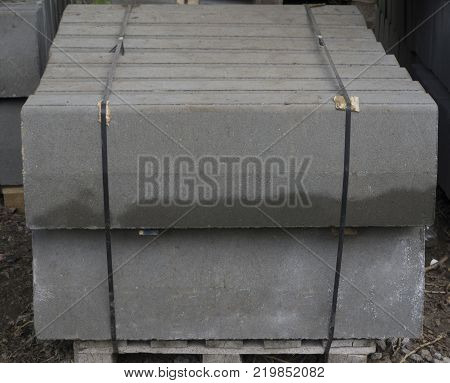 the dark one Stack of concrete curbstone. Construction process
