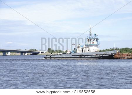 the Tug boat floats on the river