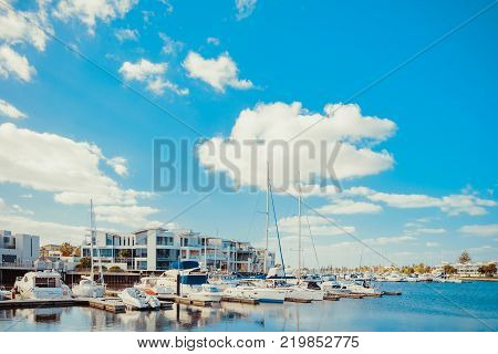 Adelaide Australia - February 3 2016: Beautiful view of boats docked in Patawalonga lake at Glenelg on a bright day. Glenelg is one of the reachest suburbs in South Australia