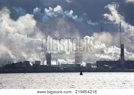 Chemical factory with smoke stack the dark one