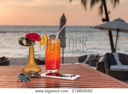Happy Hour on the beach at sunset.relaxing and holiday concept.