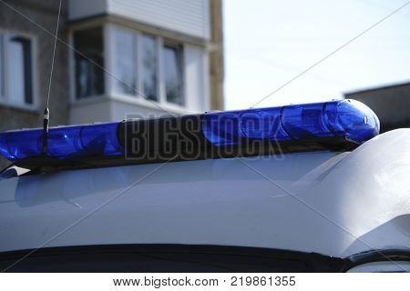 A police blue light mounted on the roof of the Polish police car and ambulance