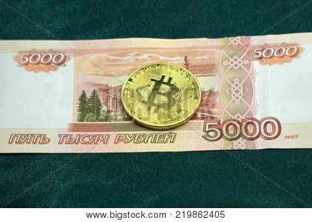 Golden bitcoins and money 5000 rubles Russian rubles and