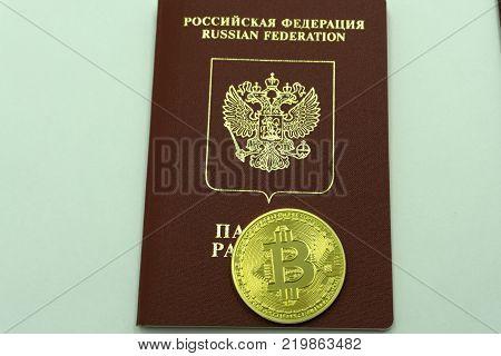 Golden bitcoin on passport as national emblem of Russian Federation