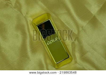 gold bar concept on a gold background