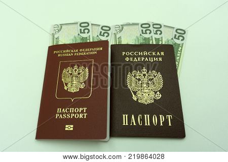 money in a passport a lot of dollars in hand capital for travel savings emigration