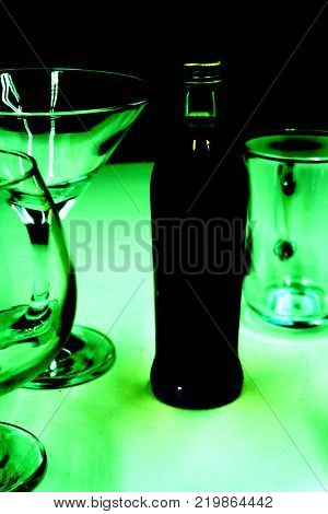 alcoholic beverages on green background lighting bokeh
