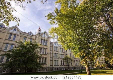 Traverse City, Michigan, USA - October 1, 2017: Exterior of the former Northern Michigan Asylum, now known as the Grand Traverse Commons. The campus offers tours, upscale condos and boutique shops.