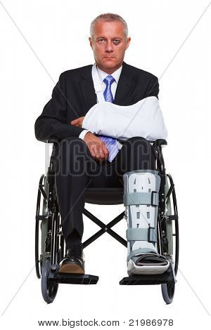 Photo of an injured businessman sitting in a wheelchair, isolated against a white background.