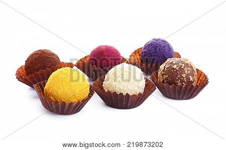 Assorted chocolate truffles on white background