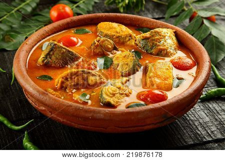 Homemade fish curry from Kerala  cuisine. served in clay pottery
