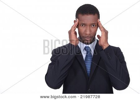 Businessman holding head