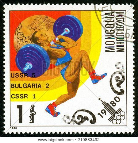 Ukraine - circa 2017: A postage stamp printed in Mongolia shows drawing Weight lifting. Series: Olympic gold medalists in 1980 Moscow. Circa 1980.