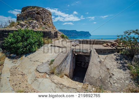 Ruins of nineteenth artillery battery, entrance to the bunker. Legacy of World War II, Balaklava, Crimea.