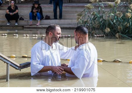 Qasr el Yahud Israel November 25 2017 : Two pilgrims make an oath during the ceremony of baptism on the Baptismal Site of Jesus Christ - Qasr el Yahud in Israel