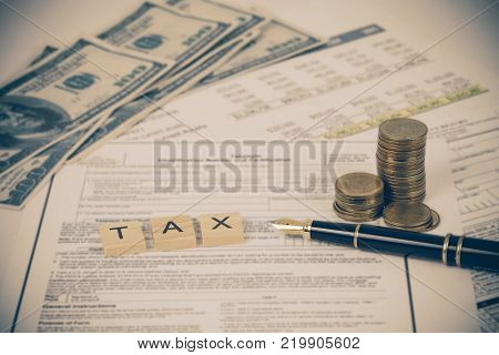 Wording Tax With Tax Documents, Money On Table. Tax Concept.